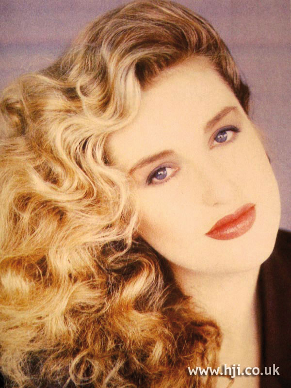 1987 long asymmetric blonde curls
