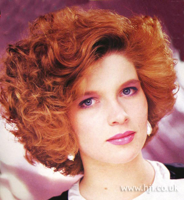1987 redhead curly hairstyle