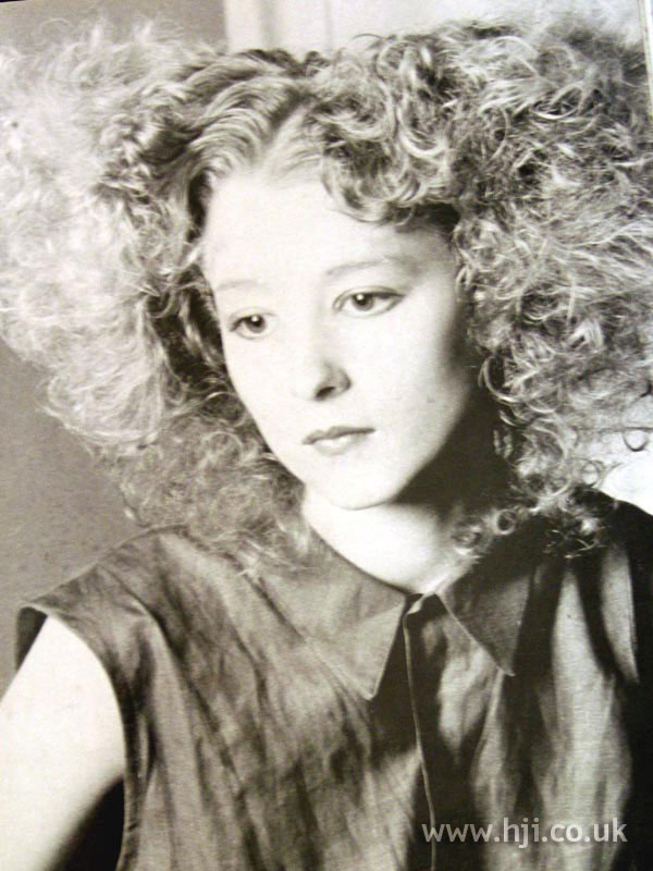 1987 big curly hairstyle
