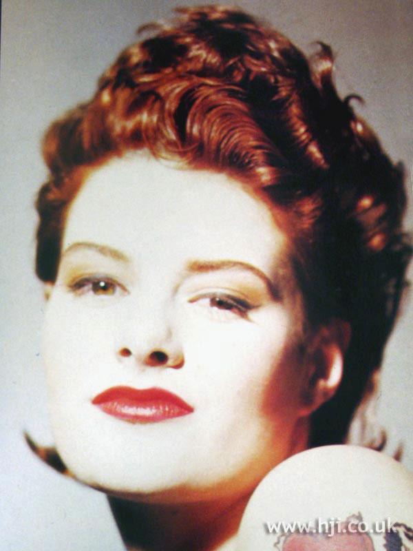 1987 wavy redhead hairstyle