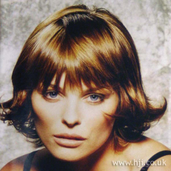 1997 brunette flicked bob hairstyle