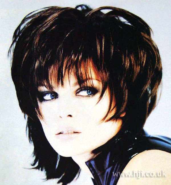 1997 layered brunette hairstyle with volume