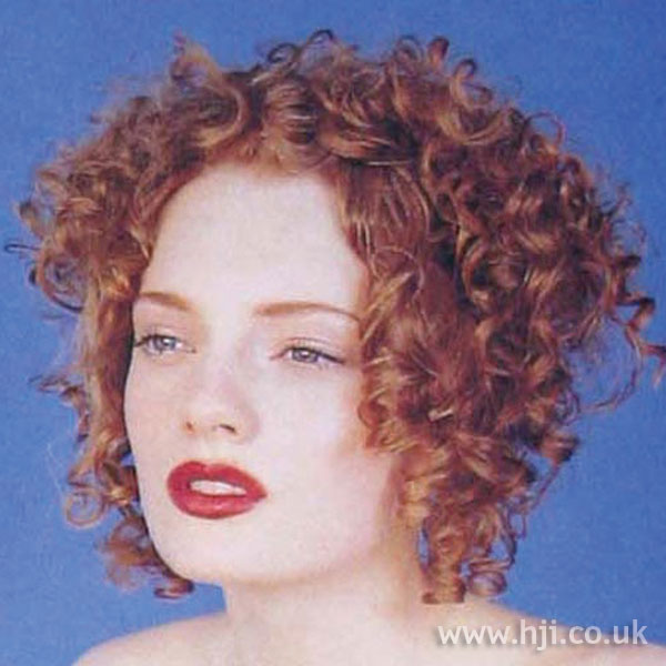 1997 short curly red hairstyle