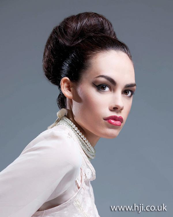 Formal bun updo by JAS Hair Group creative team