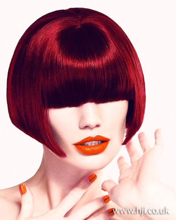 Sleek red bob with statement fringe by Martin Creane