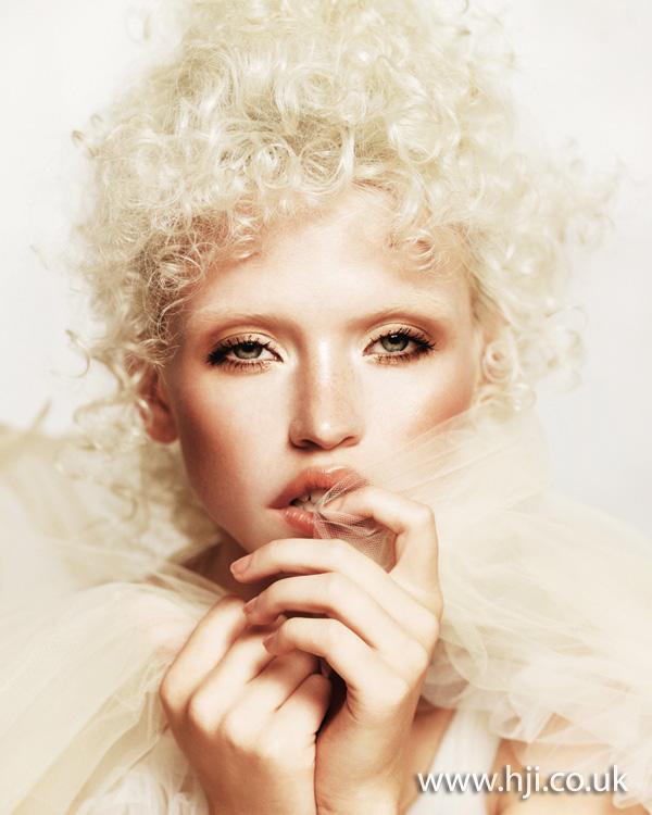 Tight platinum curls by Chumba Concept Salon artistic team