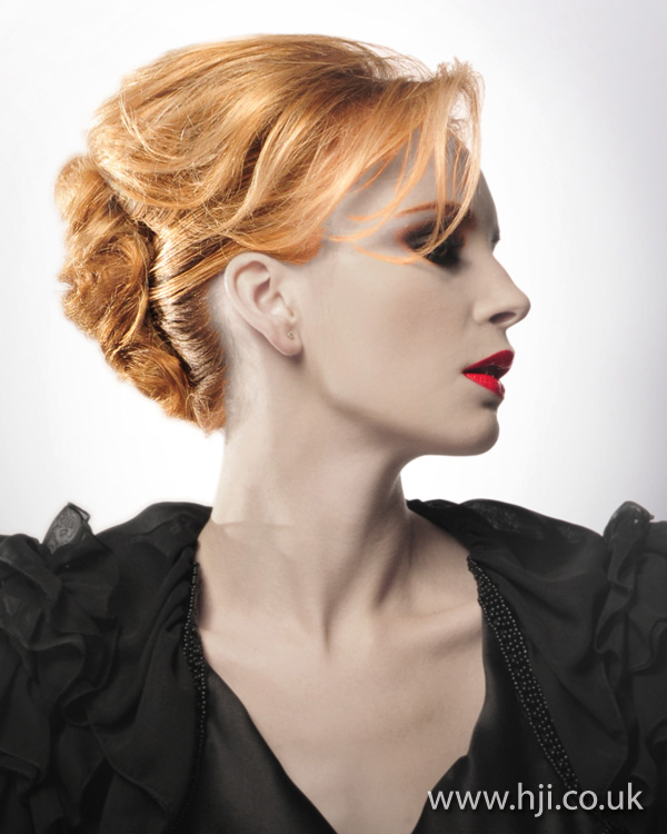 A strawberry blonde formal updo