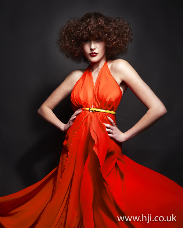 Voluminous curly hairstyle by Nick Ford