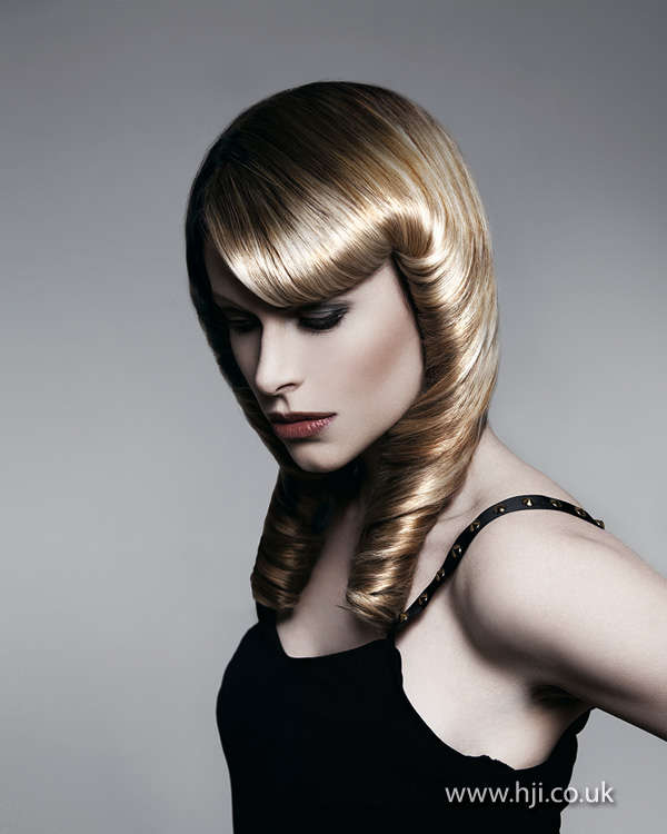 2012 long blonde womens rolled hairstyle