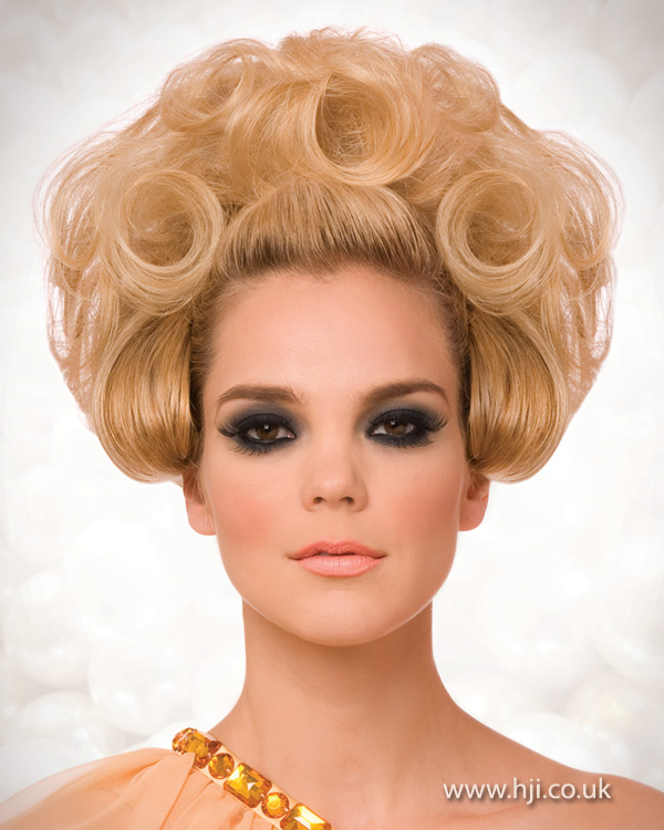 2012 rolled blonde updo hairstyle