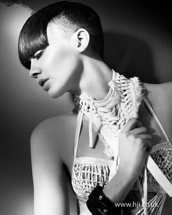 2012 shaved sides sleek fringe womens hairstyle