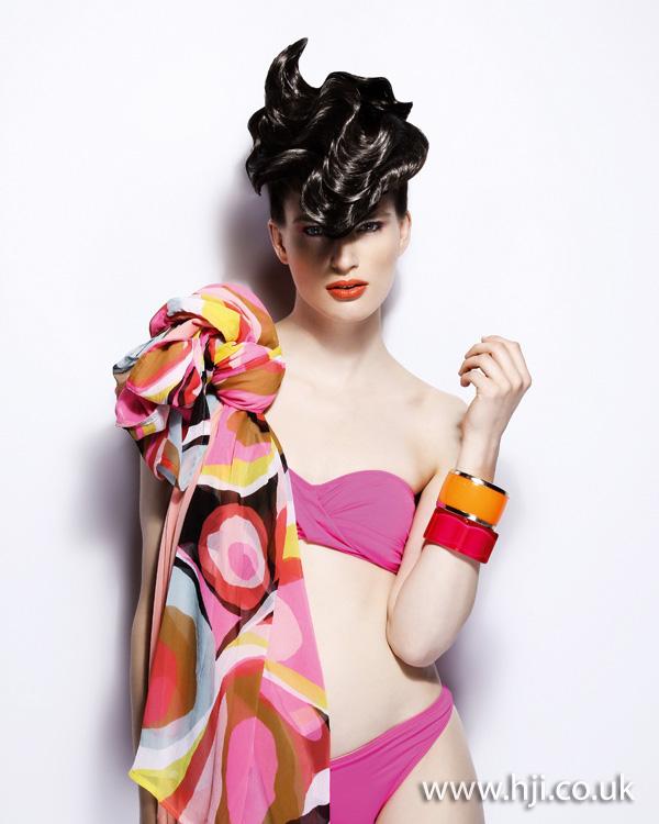 2012 shiny brunette avant garde updo hairstyle