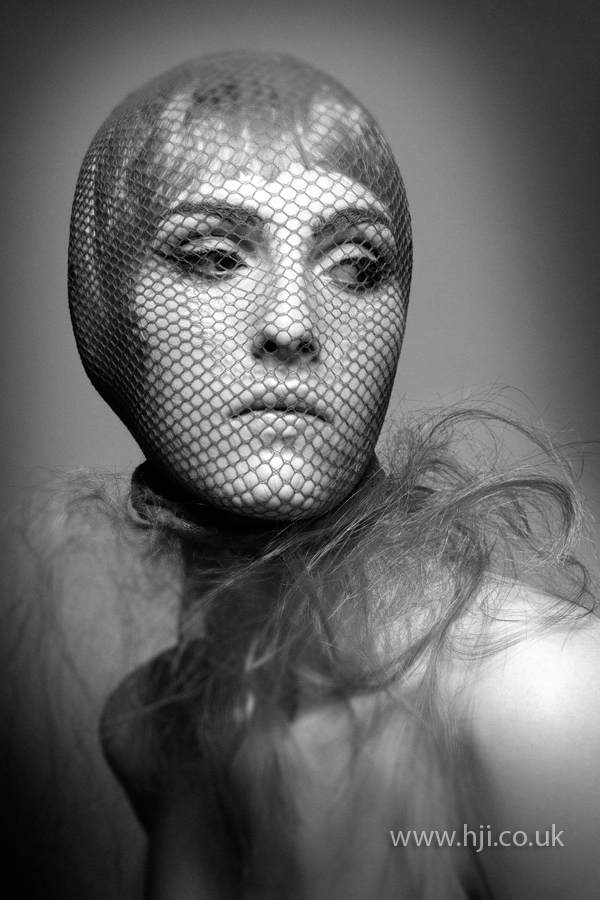 Short fringe with netted stocking over face