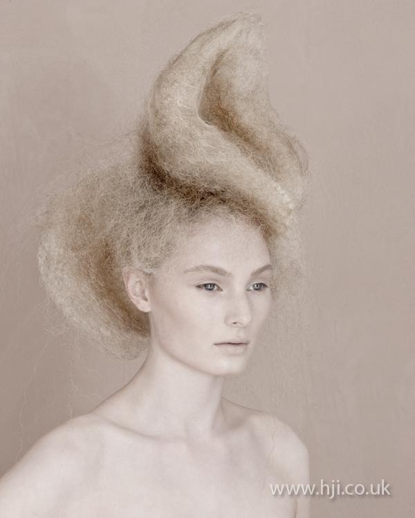 Textured blonde avant garde up do