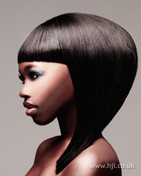 Oversized asymmetic bob with heavy sleek fringe