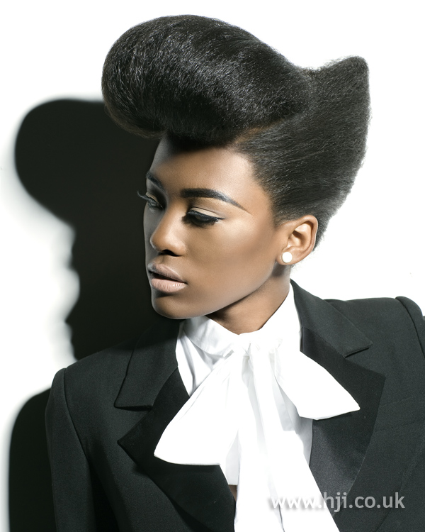 Bold afro up do with oversized quiff
