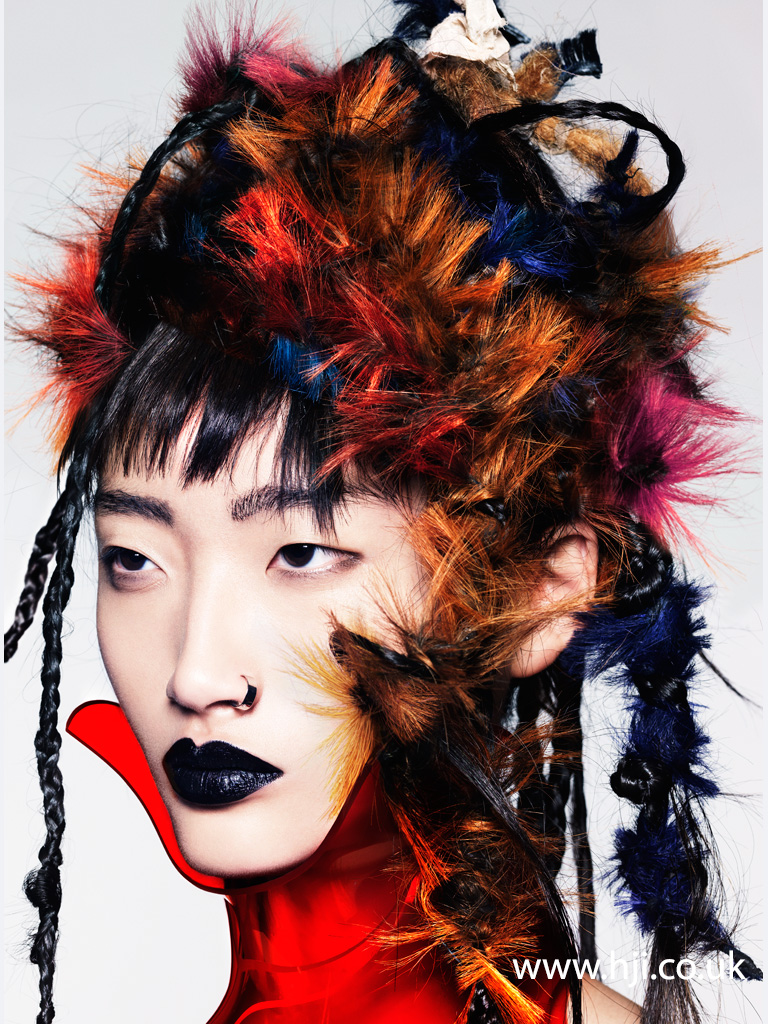 2014 Avant garde mult texted look with plaits