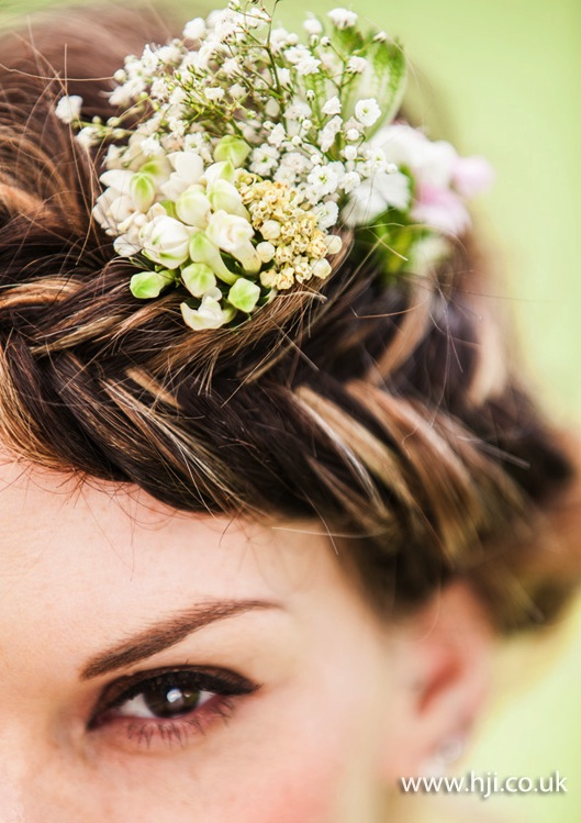 2015 fishtail braid detail with fresh flowers