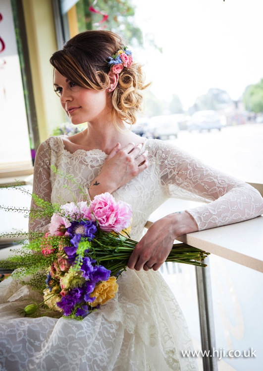 2015 romantic updo with curls and flower accent