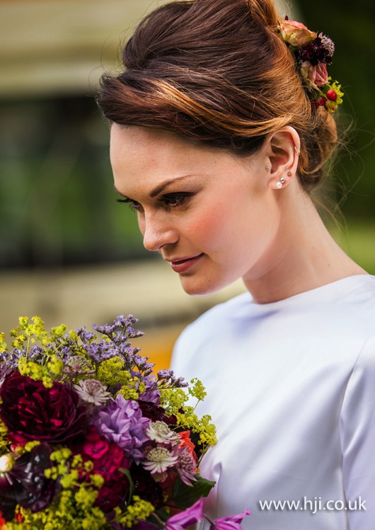 2015 smooth beehive updo with flowers
