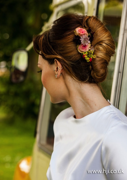 2015 smooth roll updo with flowers