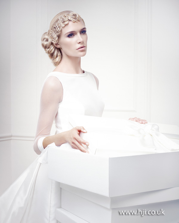 Low intricate updo for bridal hair