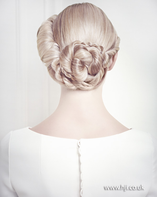 Intricate bridal updo with rope detailing