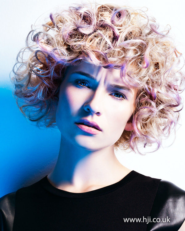 Blonde curly bob with pink accents by Marcus King