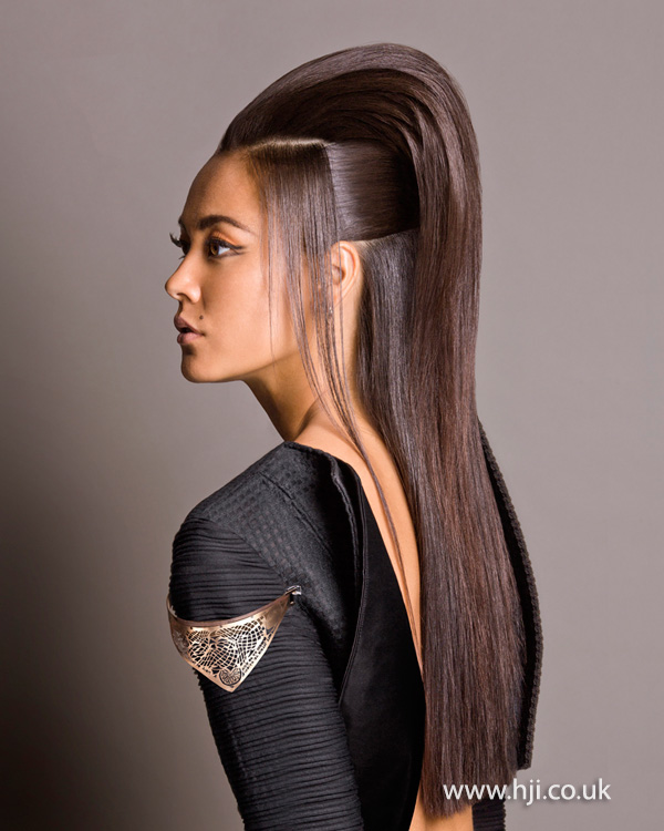 Sleek brunette hairstyle with  volume by John Castelli