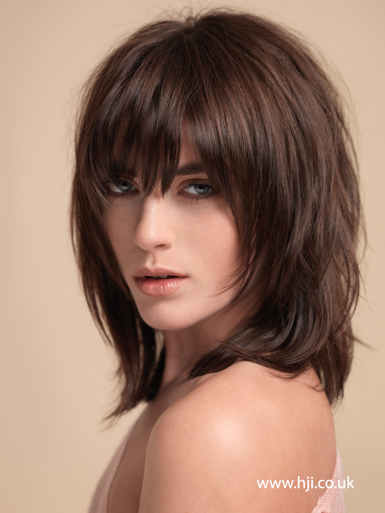 2015 dark brown layered shaggy hairstyle with full fringe