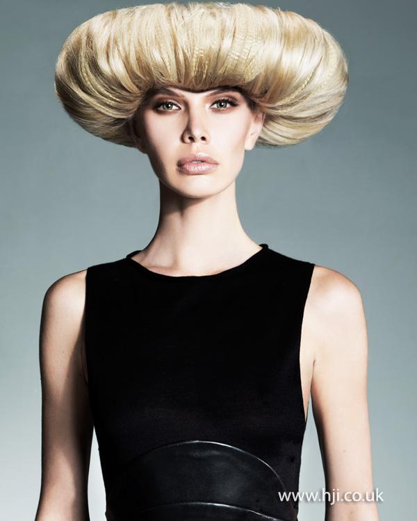 Striking blonde updo by Melanie Tudor