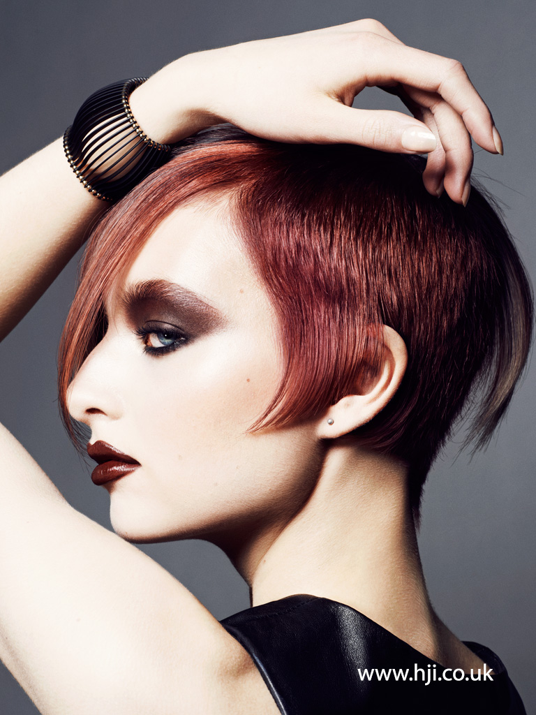Asymmetric redhead undercut hairstyle for 2015