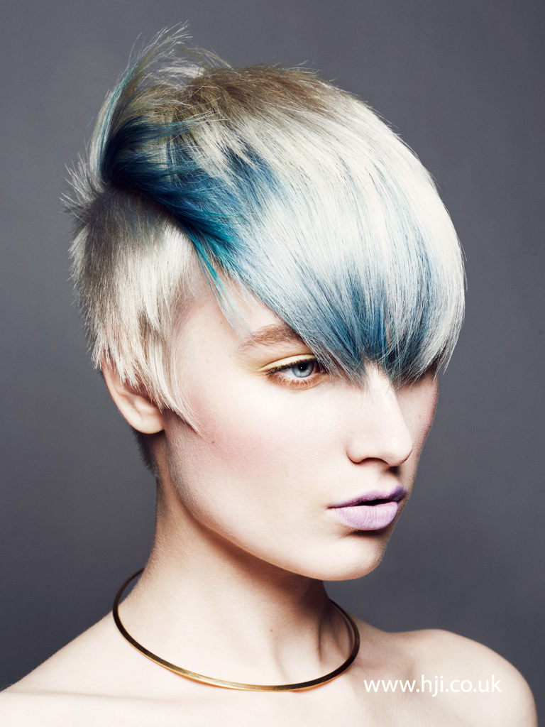 2015 textured blonde hairstyle with electric blue streaks