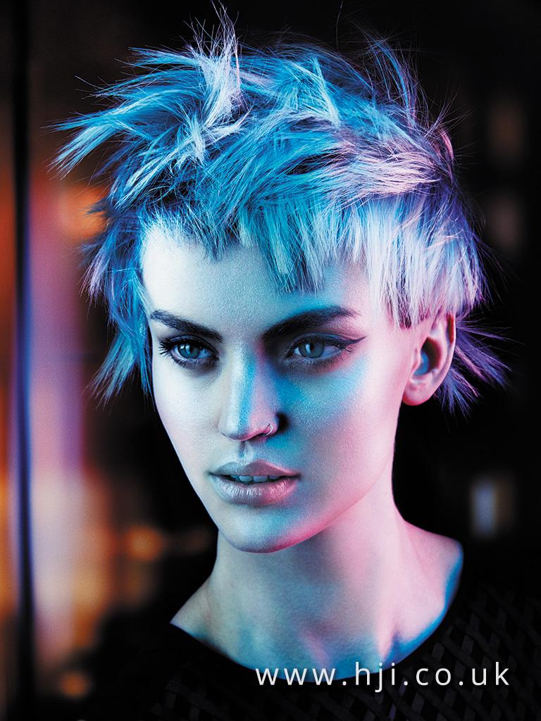 2015 choppy textured platinum pixie crop hairstyle