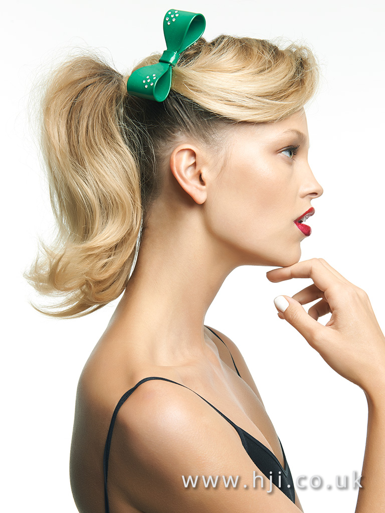 Blonde retro style ponytail with green bow