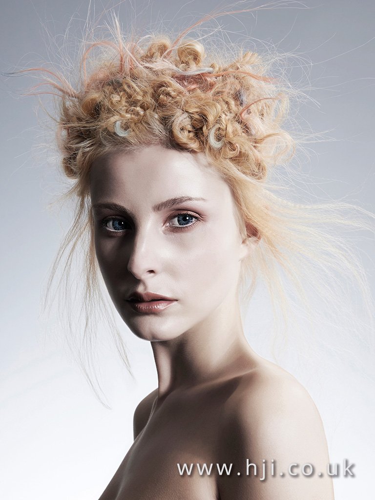 2015 Avant garde twisted updo with airy texture and pastel detailing