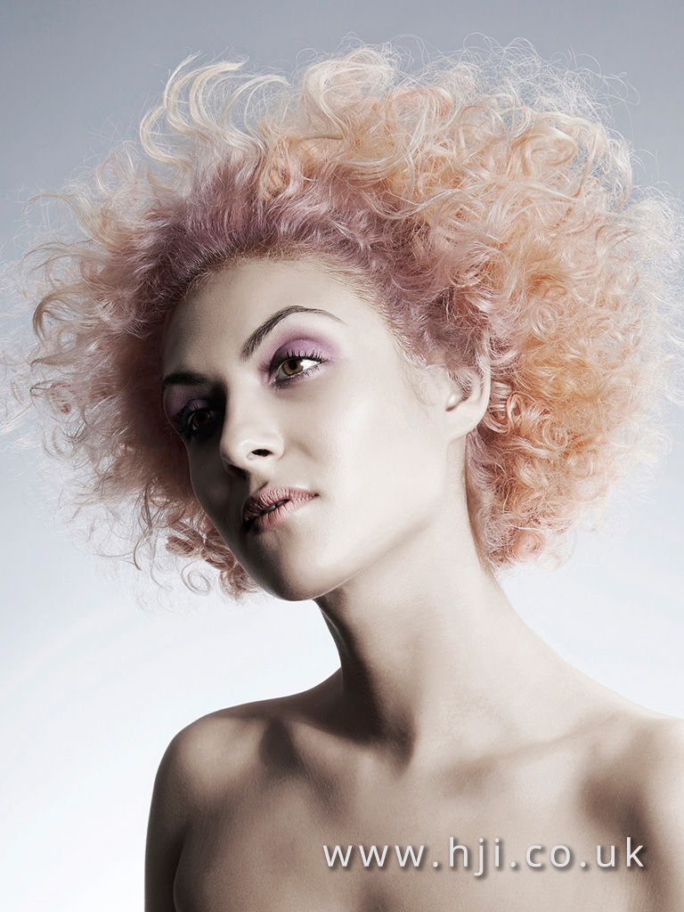 2015 Platinum blonde dressed out tight curls with pink root and coral length