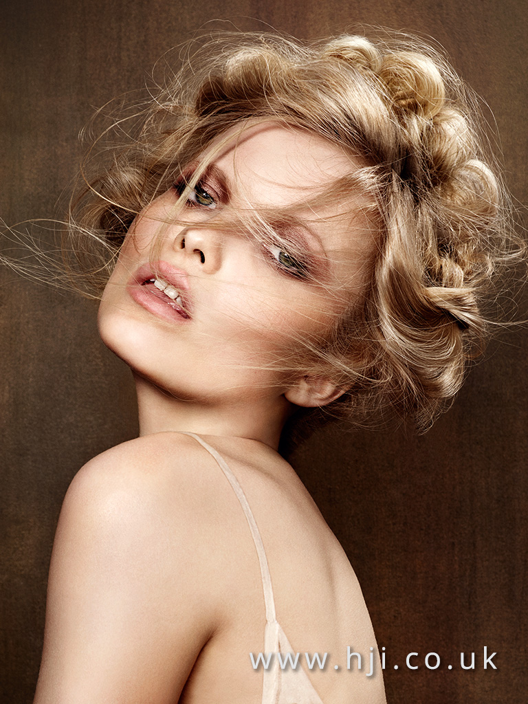 2016 Cool blonde sultry up do with face veil and rolled detail