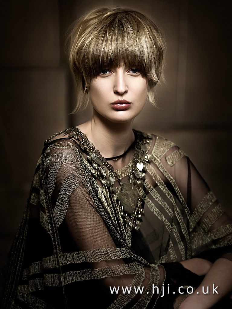 2016 Smooth textured shaggy bob with heavy fringe mid brown with highlighted slices