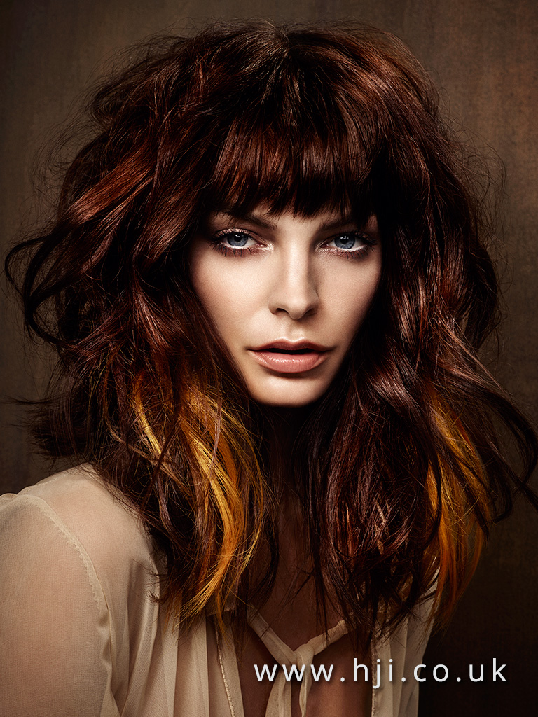 2016 big wavy redhead hairstyle with heavy fringe