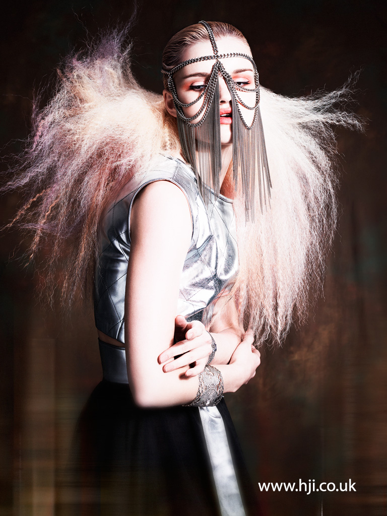 2016 pastel avant garde hairstyle with backcombed texture and chainmail mask