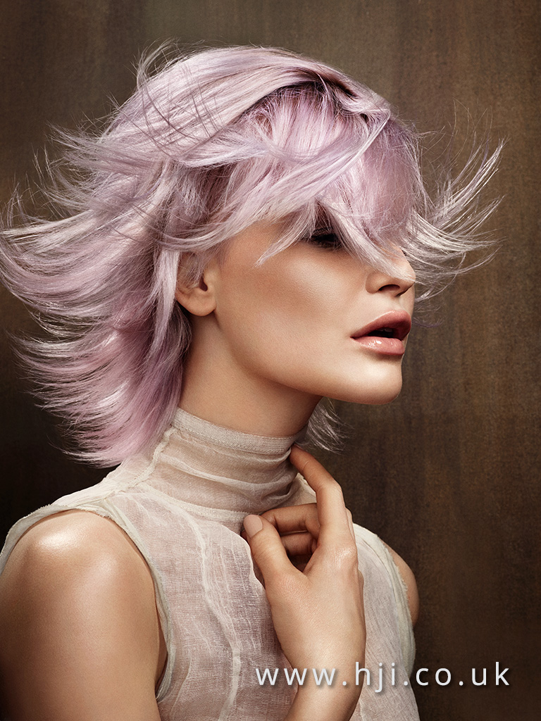 2016 pink layered hairstyle with low fringe