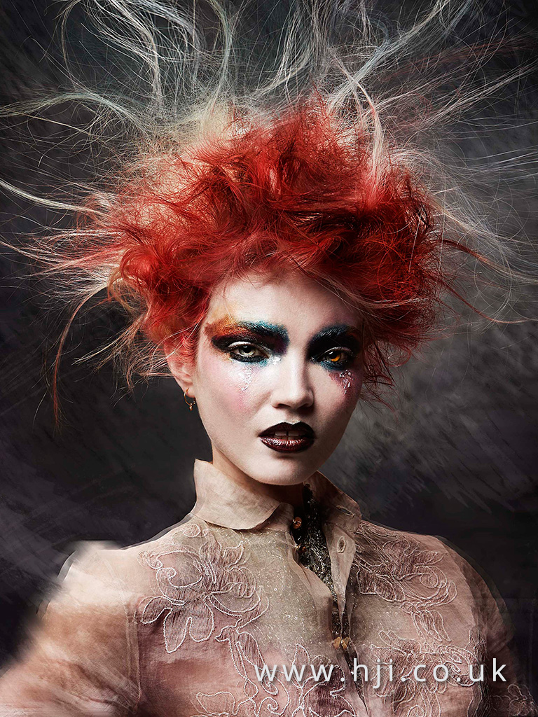 2016 messy redhead avant garde updo hairstyle with stray strands 1