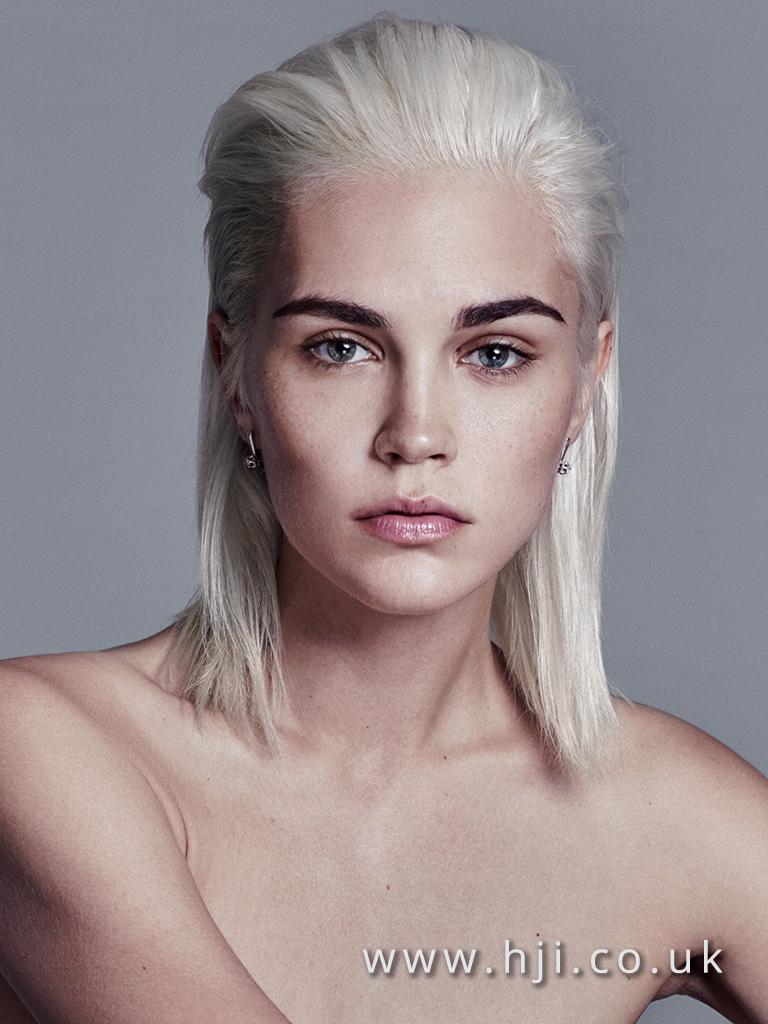 2016 slicked back paltinum blonde hairstyle