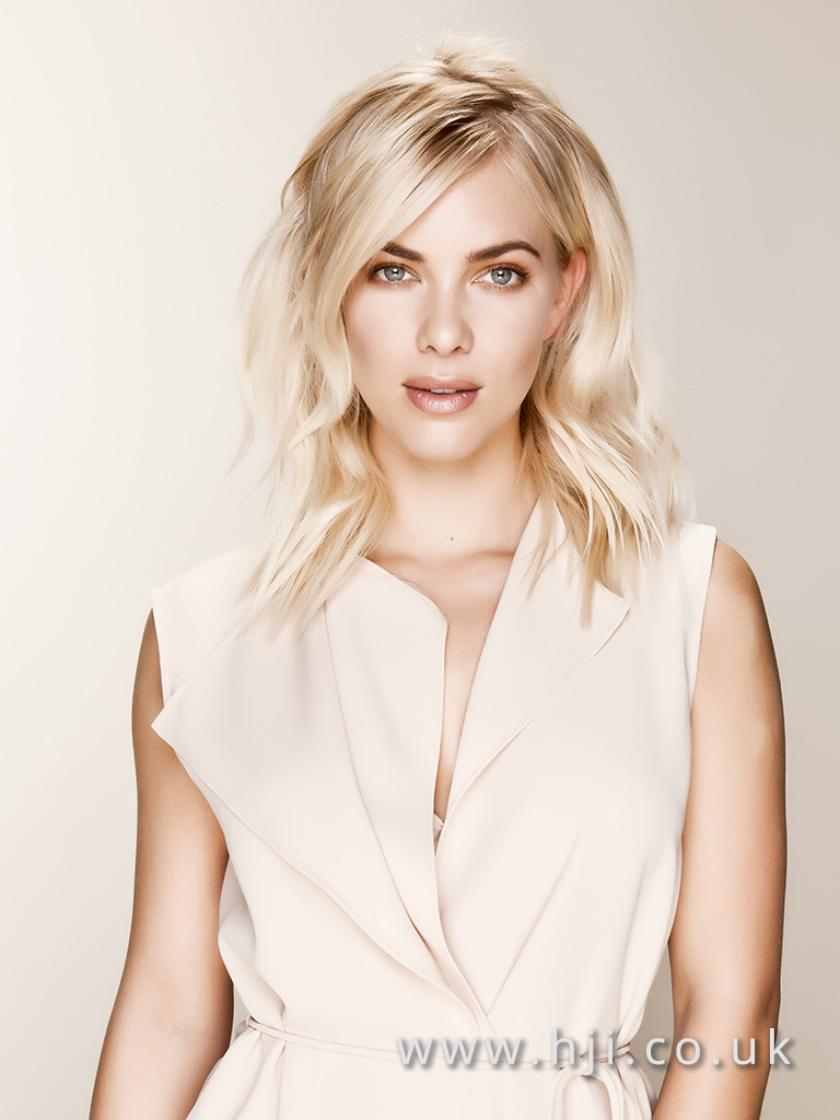 2016 Ash blonde mid length style with beachy waves and soft piecey texture