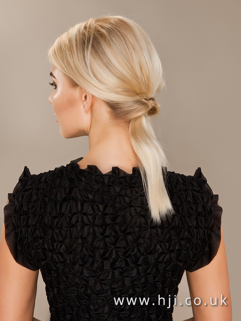 2016 Bleach blonde ponytail side view with knotted detail and face framing fringe