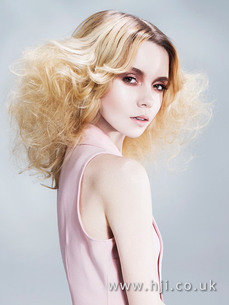 2016 Blonde mid length style with centre parting blown out fringe and voluminous glamour waves