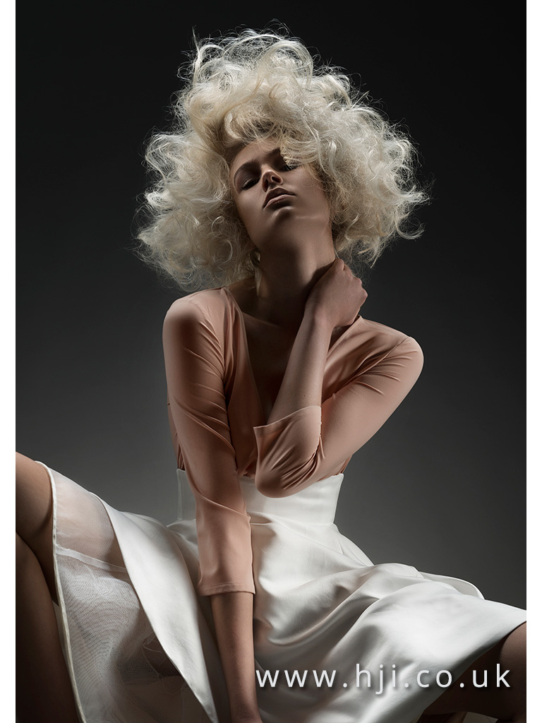 2016 Platinum blonde voluminous backcombed style wih tight curls and airy texture