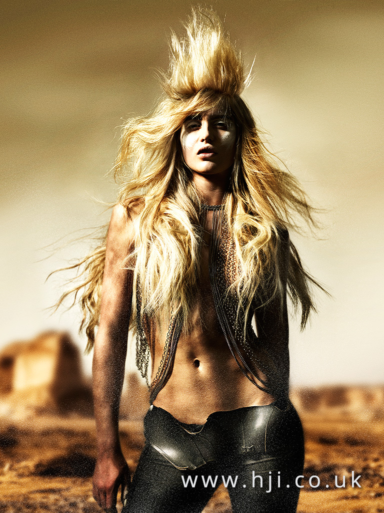 2016 Very long warm blonde style with mohawk centre section and beachy voluminous texture