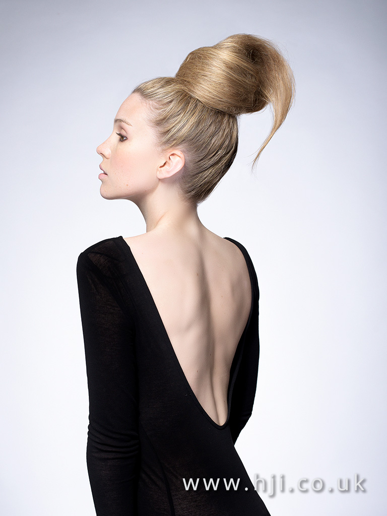 2016 Warm blonde soft texture maxi bun with backcomb and airy finish
